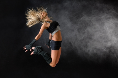 Beautiful dancer exercise jump in studio practice dancing rehearsal performance Stock Photo - 16984855