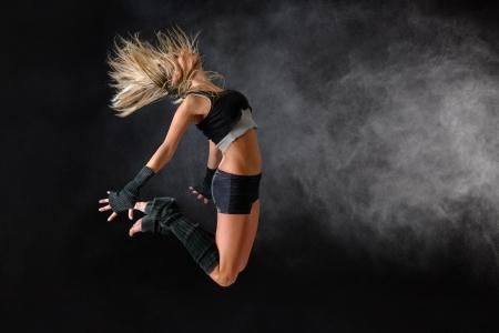 Beautiful dancer exercise jump in studio practice dancing rehearsal performance photo