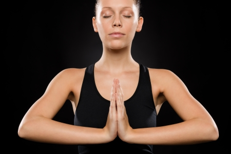 Portrait of young Caucasian woman exercising yoga with hands clasped Stock Photo - 17160273