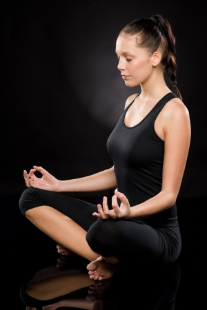 Full length of a young woman meditating with eyes closed Stock Photo - 17160278