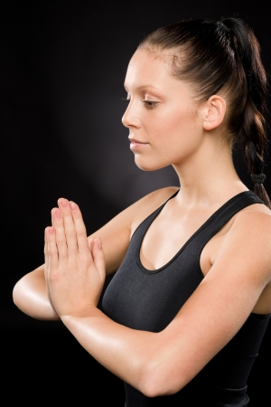 Side view of tranquil woman performing yoga with eyes closed Stock Photo - 17160253