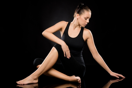 yoga pants: Full length of an attractive woman in spine twisting pose