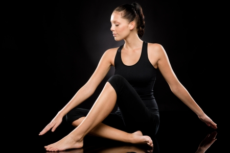 Tranquil young and barefoot woman performing yoga with stretched arms Stock Photo - 17160282
