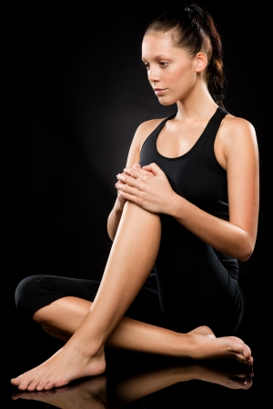 Sporty young brunette woman relaxing while doing yoga full length Stock Photo - 17160268