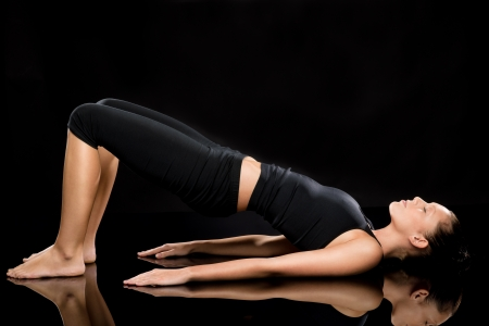yoga pants: Woman doing stretching exercise on the floor with eyes closed