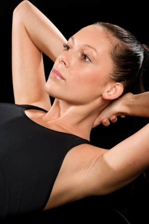 Woman performing exercises on the floor with hands behind head Stock Photo - 17160246