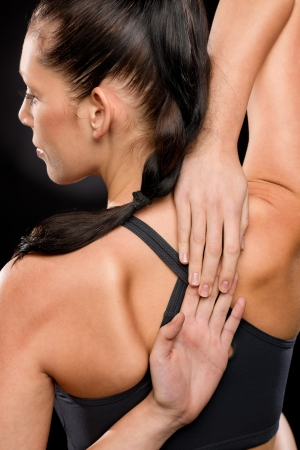 Rear view of young woman stretching her arms and back Stock Photo - 17160258