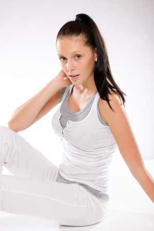 Young Caucasian woman thirsty after exercising relaxing on white background Stock Photo - 17160261