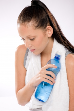 Portrait of young woman thirsty after exercises holding water bottle Stock Photo - 17160244