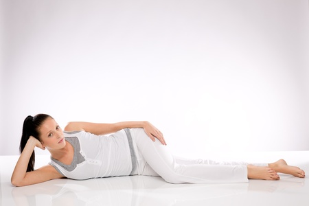 Caucasian slim young woman lying on the floor after exercises Stock Photo - 17160296
