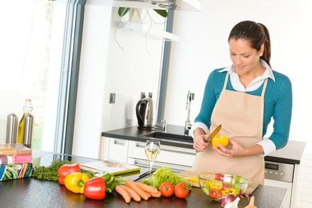 Young woman cutting vegetables kitchen preparing housework food Stock Photo - 17388949