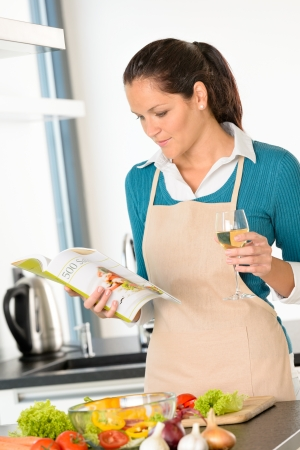 Caucasian woman preparing vegetables recipe cooking book meal kitchen Stock Photo - 17388898