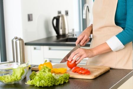Cook woman cutting tomato vegetables preparing kitchen knife salad Stock Photo - 17388928