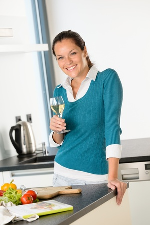 Smiling woman kitchen drinking wine preparing vegetables housewife Stock Photo - 17388903