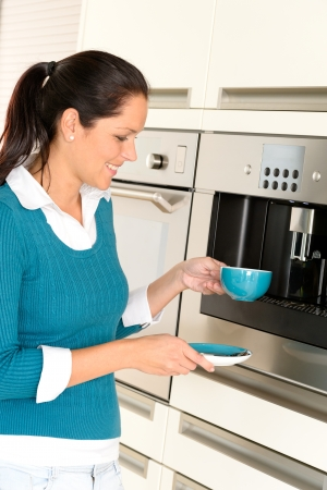 Cheerful woman making coffee machine kitchen cup preparing Stock Photo - 17388885