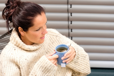 Woman drinking cup tea knitted sweater yard relaxing fall Stock Photo - 17388878