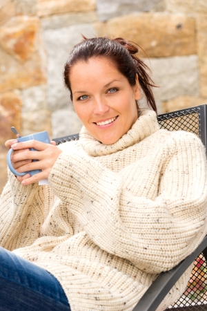 Smiling woman drinking hot cocoa sitting relaxing garden knitted sweater Stock Photo - 17388909