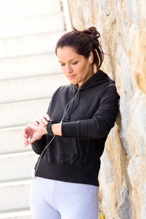 sweatsuit: Young woman checking after exercising running sport mp3 sweatsuit