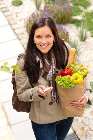 Happy woman shopping phone groceries texting vegetables mobile bag Stock Photo - 17388930