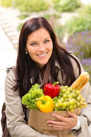 Smiling woman shopping vegetables groceries paper bag standing Stock Photo - 17388875