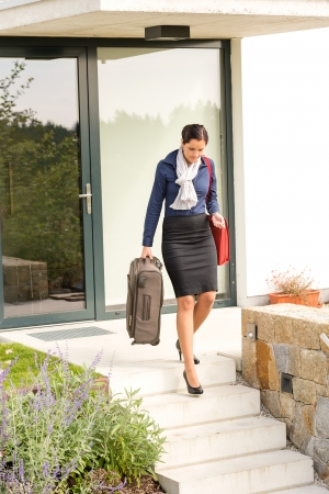 hurried: Young businesswoman rushing luggage going busy traveling carry-on Stock Photo