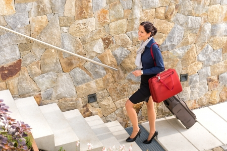 Smiling woman business going traveling baggage shoulder bag leaving Stock Photo - 17388862