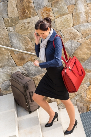 hurried: Traveling businesswoman hurried rushing climbing baggage carry-on shoulder bag Stock Photo