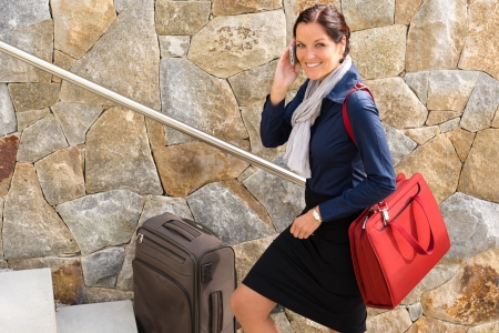 hurried: Smiling woman talking phone business baggage traveling rushing mobile smart