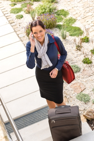 Pretty flight attendant leaving calling luggage phone rushing bag Stock Photo - 17388890