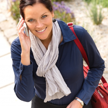 Young smiling woman talking phone calling elegance businesswoman Stock Photo - 17388994
