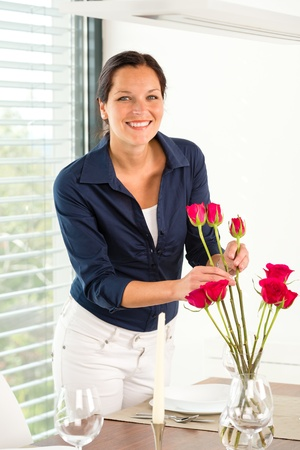 Young woman arranging flowers dinner table lunch Stock Photo - 17388935