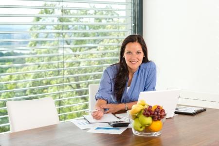 Smiling woman working home laptop business computer Standard-Bild