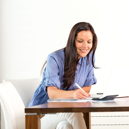 Smiling woman researching library university exam writing essay Stock Photo - 17406092