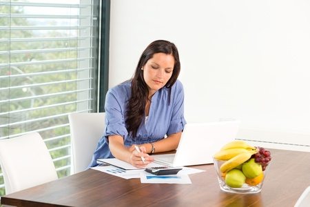 Student studying writing research examination living room laptop internet Stock Photo - 17388964