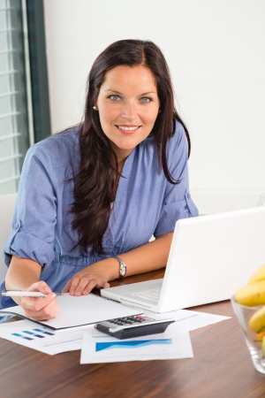 Happy businesswoman working office writing calculating finance analyzing Stock Photo - 17388919