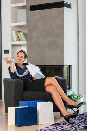 Woman looking clothes gift present living room interior domestic sale Stock Photo - 17388932