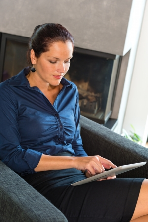 Woman working from home using her tablet Stock Photo - 17388912