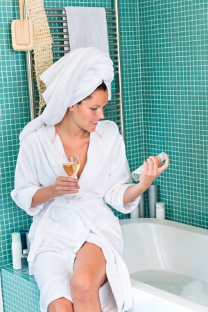 Young woman relaxing bathroom spa treatment bathtub hotel drinking wine Stock Photo - 17388876