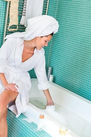 Young woman playing foam bathroom bubblebath home bathrobe hygiene Stock Photo - 17388877