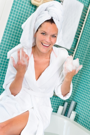 Happy woman enjoying spa treatment hotel bathroom bathrobe beauty Stock Photo - 17388924