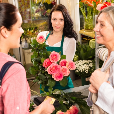 Women customers buying card flower shop pink roses florist Stock Photo - 17692564