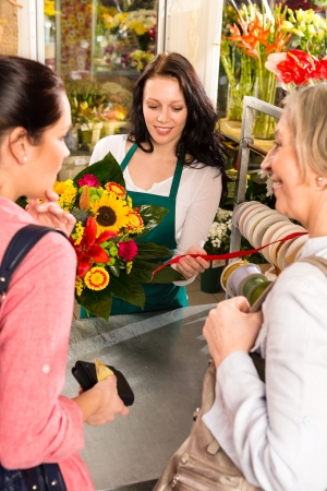 Happy women customers buying flowers sunflower bouquet shop florist Stock Photo - 17692552