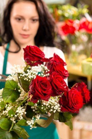 Young woman making flower bouquet florist shop roses selling Stock Photo - 17692542
