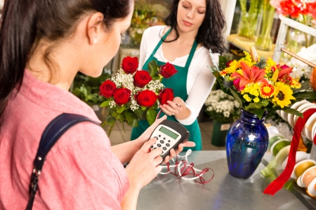 Woman customer paying flowers shop credit card florist roses Stock Photo - 17692544