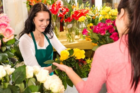 florist shop: Cheerful flower shop florist customer buying yellow bouquet women