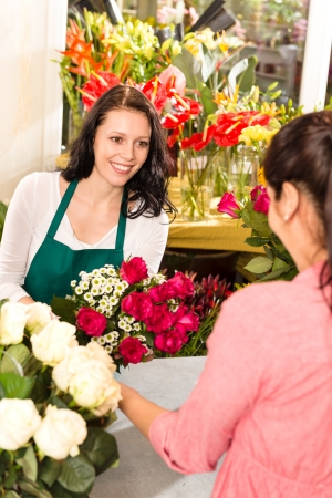 Happy florist making roses bouquet women customer buying flower shop Stock Photo - 17692547