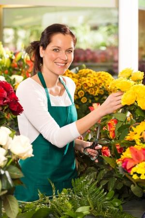 Cheerful woman flower shop market choosing working colorful market