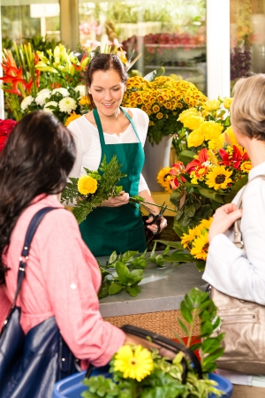 Young woman florist cutting flower shop customers retail colorful photo