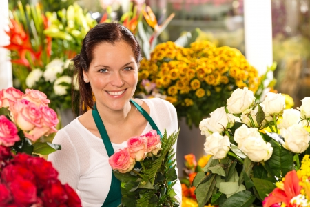small plant: Smiling florist flower shop colorful making bouquet roses market