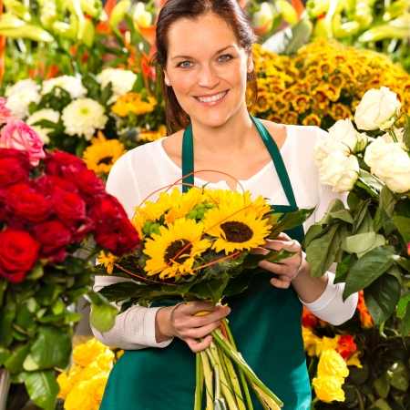 Smiling florist woman bouquet sunflowers flower shop colorful showing photo